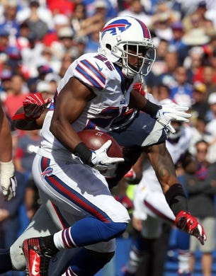 Sep 20, 2015; Orchard Park, NY, USA; Buffalo Bills running back LeSean McCoy (25) runs the ball during the second half against the New England Patriots at Ralph Wilson Stadium. Patriots defeat the Bills 40 to 32.  Mandatory Credit: Timothy T. Ludwig-USA TODAY Sports