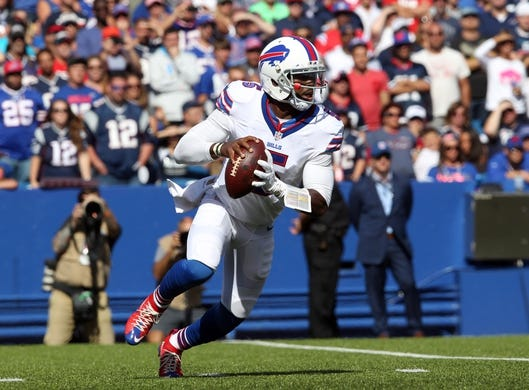 Sep 20, 2015; Orchard Park, NY, USA; Buffalo Bills quarterback Tyrod Taylor (5) looks to make a pass during the second half against the New England Patriots at Ralph Wilson Stadium. Patriots defeat the Bills 40 to 32.  Mandatory Credit: Timothy T. Ludwig-USA TODAY Sports