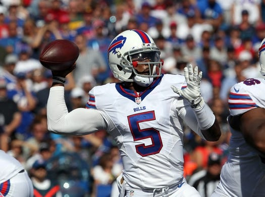 Sep 20, 2015; Orchard Park, NY, USA; Buffalo Bills quarterback Tyrod Taylor (5) throws a pass during the second half against the New England Patriots at Ralph Wilson Stadium. Patriots defeat the Bills 40 to 32.  Mandatory Credit: Timothy T. Ludwig-USA TODAY Sports