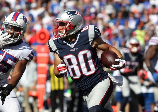 Sep 20, 2015; Orchard Park, NY, USA; New England Patriots wide receiver Danny Amendola (80) runs the ball during the second half against the Buffalo Bills at Ralph Wilson Stadium. Patriots defeat the Bills 40 to 32.  Mandatory Credit: Timothy T. Ludwig-USA TODAY Sports