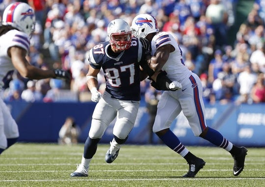 Sep 20, 2015; Orchard Park, NY, USA; Buffalo Bills outside linebacker Manny Lawson (91) tries to knock New England Patriots tight end Rob Gronkowski (87) off his pass route during the second half at Ralph Wilson Stadium. Patriots beat the Bills 40-32. Mandatory Credit: Kevin Hoffman-USA TODAY Sports