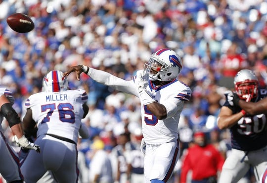 Sep 20, 2015; Orchard Park, NY, USA; Buffalo Bills quarterback Tyrod Taylor (5) throws a pass under pressure by the New England Patriots defense during the second half at Ralph Wilson Stadium. Patriots beat the Bills 40-32. Mandatory Credit: Kevin Hoffman-USA TODAY Sports