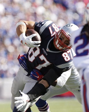 Sep 20, 2015; Orchard Park, NY, USA; New England Patriots tight end Rob Gronkowski (87) runs after a catch during the second half against the Buffalo Bills at Ralph Wilson Stadium. Patriots beat the Bills 40-32. Mandatory Credit: Kevin Hoffman-USA TODAY Sports