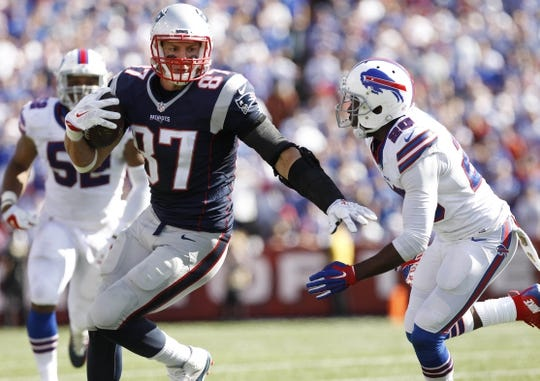Sep 20, 2015; Orchard Park, NY, USA; New England Patriots tight end Rob Gronkowski (87) runs after a catch as Buffalo Bills free safety Corey Graham (20) pursues during the second half at Ralph Wilson Stadium. Patriots beat the Bills 40-32. Mandatory Credit: Kevin Hoffman-USA TODAY Sports