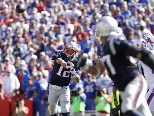 Sep 20, 2015; Orchard Park, NY, USA; New England Patriots quarterback Tom Brady (12) throws a pass tp tight end Rob Gronkowski (87) during the second against the Buffalo Bills half at Ralph Wilson Stadium. Patriots beat the Bills 40-32. Mandatory Credit: Kevin Hoffman-USA TODAY Sports
