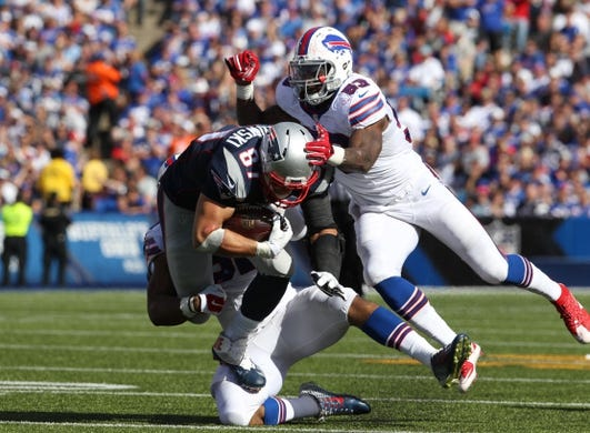 Sep 20, 2015; Orchard Park, NY, USA; New England Patriots tight end Rob Gronkowski (87) gets tackled by Buffalo Bills outside linebacker Nigel Bradham (53) and middle linebacker Preston Brown (52) during the second half at Ralph Wilson Stadium. Patriots defeat the Bills 40 to 32.  Mandatory Credit: Timothy T. Ludwig-USA TODAY Sports