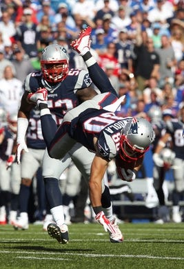 Sep 20, 2015; Orchard Park, NY, USA; New England Patriots wide receiver Danny Amendola (80) gets tripped during the second half against the Buffalo Bills at Ralph Wilson Stadium. Patriots defeat the Bills 40 to 32.  Mandatory Credit: Timothy T. Ludwig-USA TODAY Sports