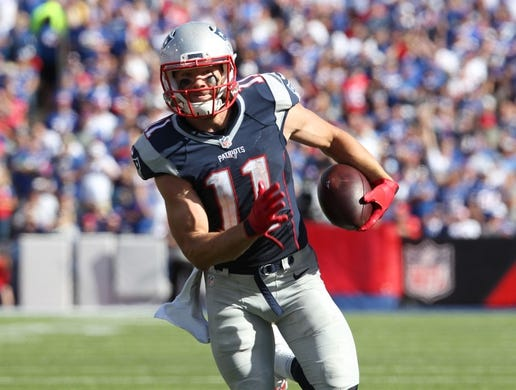 Sep 20, 2015; Orchard Park, NY, USA; New England Patriots wide receiver Julian Edelman (11) runs the ball after a catch during the second half against the Buffalo Bills at Ralph Wilson Stadium. Patriots defeat the Bills 40 to 32.  Mandatory Credit: Timothy T. Ludwig-USA TODAY Sports