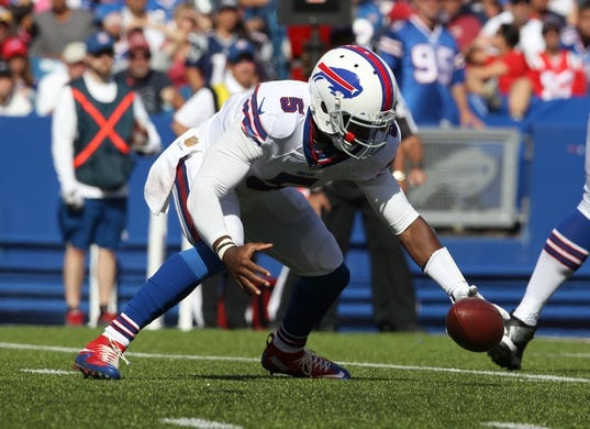 Sep 20, 2015; Orchard Park, NY, USA; Buffalo Bills quarterback Tyrod Taylor (5) fumbles the snap during the second half against the New England Patriots at Ralph Wilson Stadium. Patriots defeat the Bills 40 to 32.  Mandatory Credit: Timothy T. Ludwig-USA TODAY Sports