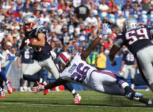 Sep 20, 2015; Orchard Park, NY, USA; Buffalo Bills running back Anthony Dixon (26) dives to try and tackle New England Patriots wide receiver Danny Amendola (80) during the second half at Ralph Wilson Stadium. Patriots defeat the Bills 40 to 32.  Mandatory Credit: Timothy T. Ludwig-USA TODAY Sports