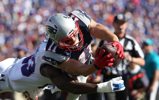Sep 20, 2015; Orchard Park, NY, USA; Buffalo Bills strong safety Aaron Williams (23) dives to try and tackle New England Patriots wide receiver Julian Edelman (11) during the second half at Ralph Wilson Stadium. Patriots defeat the Bills 40 to 32.  Mandatory Credit: Timothy T. Ludwig-USA TODAY Sports