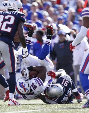 Sep 20, 2015; Orchard Park, NY, USA; Buffalo Bills running back LeSean McCoy (25) is tackled by New England Patriots outside linebacker Jamie Collins (91) during the second half at Ralph Wilson Stadium. Patriots beat the Bills 40-32. Mandatory Credit: Kevin Hoffman-USA TODAY Sports