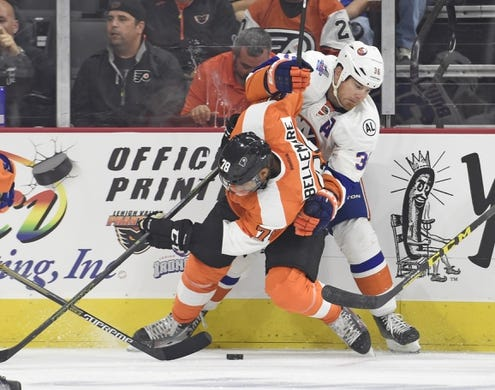Sep 21, 2015; Philadelphia, PA, USA; New York Islanders left wing Eric Boulton (36) battles with Philadelphia Flyers right wing Pierre-Edouard Bellemare (78) during the first period at PPL Center. Mandatory Credit: Eric Hartline-USA TODAY Sports