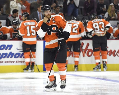 Sep 21, 2015; Philadelphia, PA, USA; Philadelphia Flyers center Claude Giroux (28) skates during a stop in play against the New York Islanders during the first period at PPL Center. Mandatory Credit: Eric Hartline-USA TODAY Sports