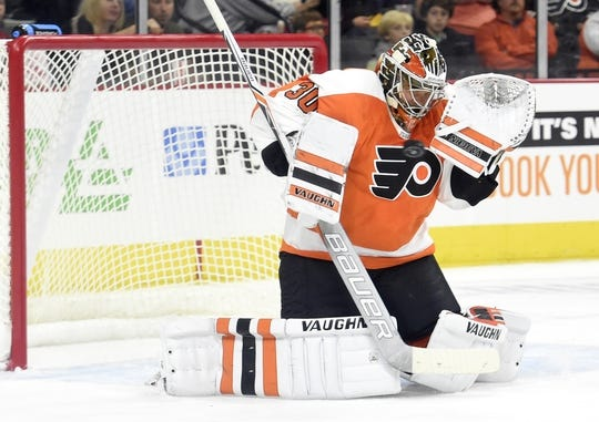 Sep 21, 2015; Philadelphia, PA, USA; Philadelphia Flyers goalie Michal Neuvirth (30) makes a save against the New York Islanders during the first period at PPL Center. Mandatory Credit: Eric Hartline-USA TODAY Sports