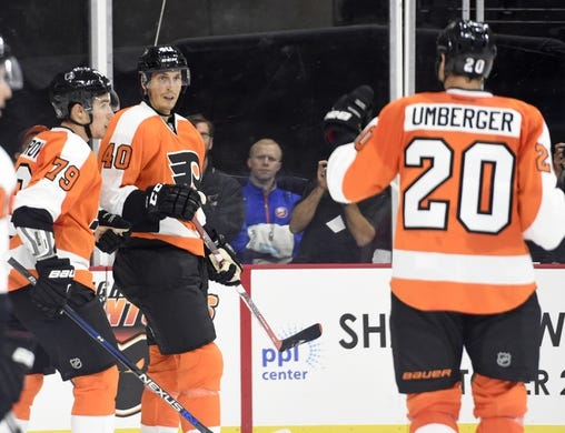 Sep 21, 2015; Philadelphia, PA, USA; Philadelphia Flyers center Vincent Lecavalier (40) celebrates his goal with defenseman Ivan Provorov (79) and left wing R.J. Umberger (20) against the New York Islanders during the second period at PPL Center. Mandatory Credit: Eric Hartline-USA TODAY Sports