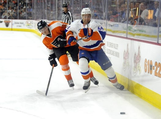 Sep 21, 2015; Philadelphia, PA, USA; New York Islanders defenseman Calvin de Haan (44) skates past check from Philadelphia Flyers defenseman Yevgeni Medvedev (82) during the third period at PPL Center. The Flyers defeated the Islanders, 5-3. Mandatory Credit: Eric Hartline-USA TODAY Sports