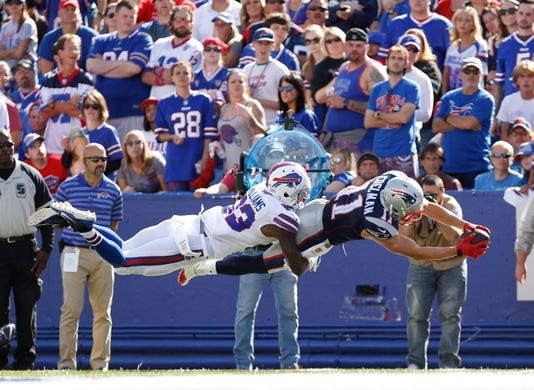 Sep 20, 2015; Orchard Park, NY, USA; New England Patriots wide receiver Julian Edelman (11) dives for a touchdown as Buffalo Bills strong safety Aaron Williams (23) defends during the second half at Ralph Wilson Stadium. Mandatory Credit: Kevin Hoffman-USA TODAY Sports