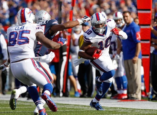 Sep 20, 2015; Orchard Park, NY, USA; Buffalo Bills wide receiver Robert Woods (10) runs after a catch as New England Patriots defensive back Bradley Fletcher (24) pursues during the second half at Ralph Wilson Stadium. Mandatory Credit: Kevin Hoffman-USA TODAY Sports