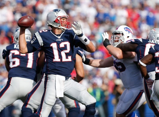 Sep 20, 2015; Orchard Park, NY, USA; New England Patriots quarterback Tom Brady (12) drops to pass under pressure by Buffalo Bills defensive tackle Kyle Williams (95) during the second half at Ralph Wilson Stadium. Patriots beat the Bills 40-32. Mandatory Credit: Kevin Hoffman-USA TODAY Sports