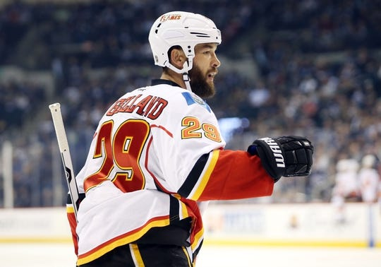 Oct 1, 2015; Winnipeg, Manitoba, CAN; Calgary Flames defenseman Deryk Engelland (29) celebrates his goal against the Winnipeg Jets during the first period at MTS Centre. Mandatory Credit: Bruce Fedyck-USA TODAY Sports