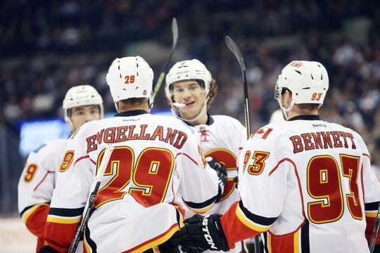 Oct 1, 2015; Winnipeg, Manitoba, CAN; Calgary Flames defenseman Deryk Engelland (29) celebrates his goal with teammates against the Winnipeg Jets during the first period at MTS Centre. Mandatory Credit: Bruce Fedyck-USA TODAY Sports