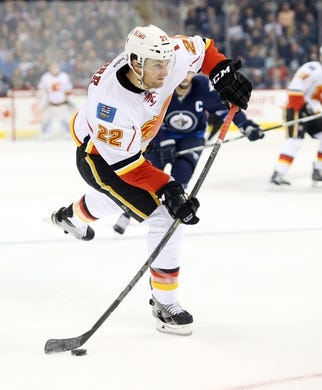 Oct 1, 2015; Winnipeg, Manitoba, CAN; Calgary Flames center Drew Shore (22) during the first period against the Winnipeg Jets at MTS Centre. Mandatory Credit: Bruce Fedyck-USA TODAY Sports