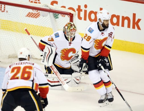 Oct 1, 2015; Winnipeg, Manitoba, CAN; Calgary Flames defenseman Deryk Engelland (29) blocks a shot during the second period against the Winnipeg Jets at MTS Centre. Mandatory Credit: Bruce Fedyck-USA TODAY Sports