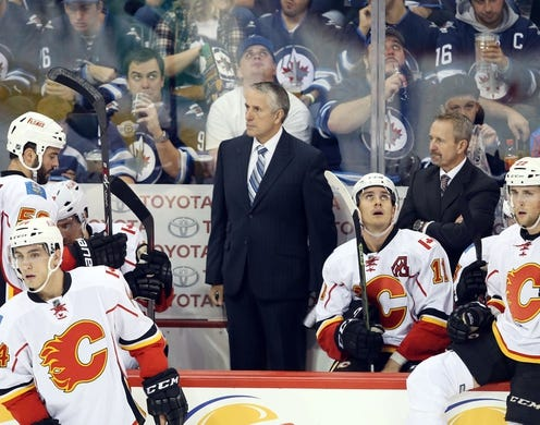 Oct 1, 2015; Winnipeg, Manitoba, CAN; Calgary Flames head coach Bob Hartley reacts during the second against the Winnipeg Jets at MTS Centre. Mandatory Credit: Bruce Fedyck-USA TODAY Sports