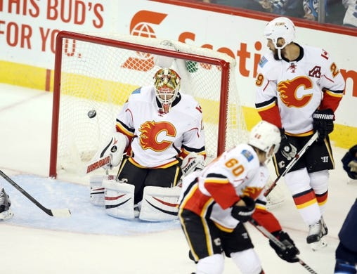 Oct 1, 2015; Winnipeg, Manitoba, CAN;  Winnipeg Jets  forward  Mark Scheifele (not pictured) scores on Calgary Flames goalie Joni Ortio (37) during the second period at MTS Centre. Mandatory Credit: Bruce Fedyck-USA TODAY Sports