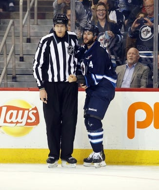 Oct 1, 2015; Winnipeg, Manitoba, CAN; Winnipeg Jets  forward  Anthony Peluso (14) after he fights Calgary Flames left wing Brandon Bollig (52) (not shown) during the third period at MTS Centre. Winnipeg wins 3-1. Mandatory Credit: Bruce Fedyck-USA TODAY Sports