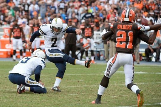 Oct 4, 2015; San Diego, CA, USA; San Diego Chargers kicker Josh Lambo (2) kicks a 34-yard field goal out of the hold of San Diego Chargers punter Mike Scifres (5) with no time on the clock against the Cleveland Browns at Qualcomm Stadium. The Charger won 3-0-27. Mandatory Credit: Robert Hanashiro-USA TODAY Sports
