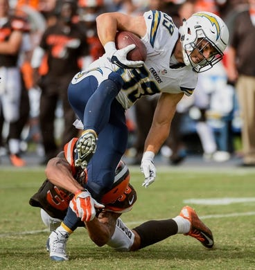 Oct 4, 2015; San Diego, CA, USA; San Diego Chargers running back Danny Woodhead (39) tries to high step out of a tackle by Cleveland Browns cornerback Jordan Poyer (33) for a 19-yard gain in the closing minute of the fourth quarter at Qualcomm Stadium. The Chargers went on to a 30-27 win. Mandatory Credit: Robert Hanashiro-USA TODAY Sports