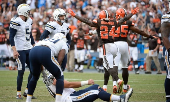 Oct 4, 2015; San Diego, CA, USA; Cleveland Browns cornerback Johnson Bademosi (24) and outside linebacker Armonty Bryant (95) celebrate a missed field goal by San Diego Chargers kicker Josh Lambo (2) at the end of the fourth quarter that would have won the game at Qualcomm Stadium. However a penalty on Cleveland allowed Lambo a second chance and he did not miss as the Chargers won 30-27. Mandatory Credit: Robert Hanashiro-USA TODAY Sports