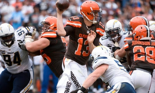 Oct 4, 2015; San Diego, CA, USA; Cleveland Browns quarterback Josh McCown (13) pressured in the pocket by the San Diego Chargers defense during the third quarter at Qualcomm Stadium. The Chargers went on to a 30-27 win. Mandatory Credit: Robert Hanashiro-USA TODAY Sports