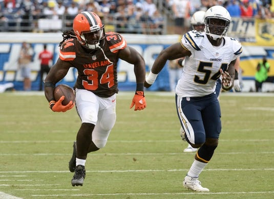 Oct 4, 2015; San Diego, CA, USA; Cleveland Browns running back Isaiah Crowell (34) sprints down the sideline as he is chased by San Diego Chargers outside linebacker Melvin Ingram (54) on his way to a 32-yard gain in the third quarter at Qualcomm Stadium. Mandatory Credit: Robert Hanashiro-USA TODAY Sports
