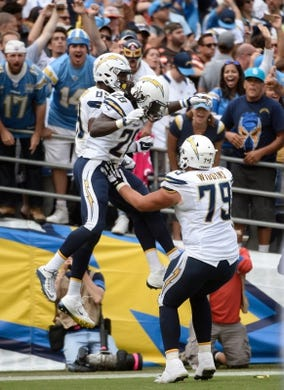 Oct 4, 2015; San Diego, CA, USA; San Diego Chargers tight end Ladarius Green (89) celebrates his third quarter touchdown with teammates running back Melvin Gordon (28) and offensive tackle Kenny Wiggins (79) against the Cleveland Browns at Qualcomm Stadium. The Chargers went on to a 30-27 win. Mandatory Credit: Robert Hanashiro-USA TODAY Sports