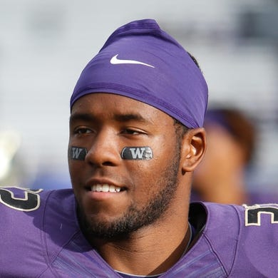 Sep 19, 2015; Seattle, WA, USA; Washington Huskies defensive back Budda Baker (32) walks back to the locker room after a game against the Utah State Aggies at Husky Stadium. Mandatory Credit: Jennifer Buchanan-USA TODAY Sports