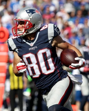 Sep 20, 2015; Orchard Park, NY, USA; New England Patriots wide receiver Danny Amendola (80) runs the ball against the Buffalo Bills at Ralph Wilson Stadium. Patriots defeat the Bills 40 to 32.  Mandatory Credit: Timothy T. Ludwig-USA TODAY Sports