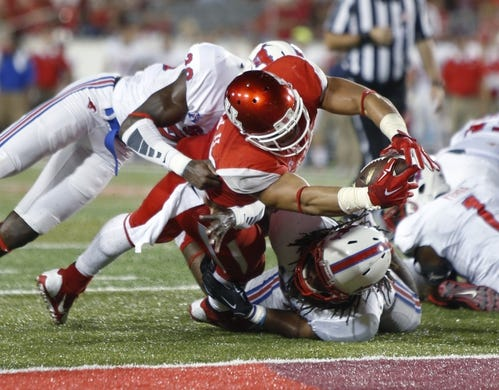 Oct 8, 2015; Houston, TX, USA; University of Houston Cougars running back Kenneth Farrow (35) stretches over the goal line for a touchdown against the Southern Methodist University Mustangs in the second half at TDECU Stadium. Mandatory Credit: Erich Schlegel-USA TODAY Sports
