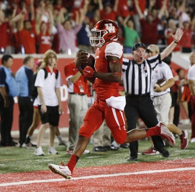 Oct 8, 2015; Houston, TX, USA; University of Houston Cougars quarterback Greg Ward, Jr. (1) scores a touchdown on a keeper against the Southern Methodist University Mustangs in the second half at TDECU Stadium. Mandatory Credit: Erich Schlegel-USA TODAY Sports