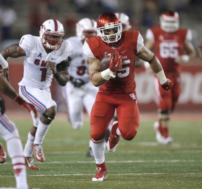 Oct 8, 2015; Houston, TX, USA; University of Houston Cougars running back Kenneth Farrow (35) carries against the Southern Methodist University Mustangs in the second half at TDECU Stadium. Mandatory Credit: Erich Schlegel-USA TODAY Sports