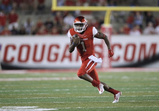 Oct 8, 2015; Houston, TX, USA; University of Houston Cougars quarterback Greg Ward, Jr. (1) runs on a keeper against the Southern Methodist University Mustangs in the second half at TDECU Stadium. Mandatory Credit: Erich Schlegel-USA TODAY Sports