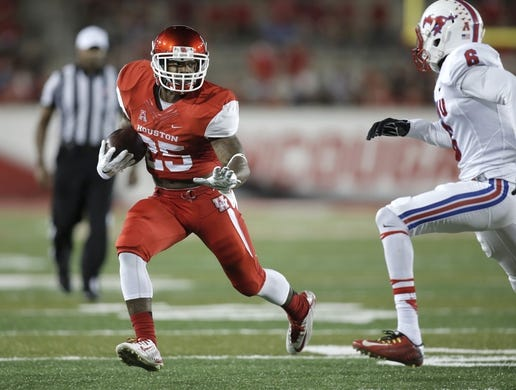 Oct 8, 2015; Houston, TX, USA; University of Houston Cougars running back Javin Webb (25) runs against Southern Methodist University Mustangs defensive back Jesse Montgomery (6) in the second half at TDECU Stadium. Mandatory Credit: Erich Schlegel-USA TODAY Sports