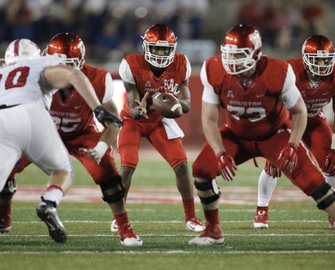 Oct 8, 2015; Houston, TX, USA; University of Houston Cougars quarterback Greg Ward, Jr. (1) takes a snap against the Southern Methodist University Mustangs in the second half at TDECU Stadium. Mandatory Credit: Erich Schlegel-USA TODAY Sports