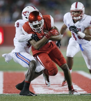 Oct 8, 2015; Houston, TX, USA; University of Houston Cougars wide receiver Chance Allen (21) is tackled by Southern Methodist University Mustangs defensive back Horace Richardson (9) in the second half at TDECU Stadium. Mandatory Credit: Erich Schlegel-USA TODAY Sports