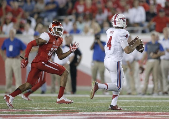 Oct 8, 2015; Houston, TX, USA; University of Houston Cougars defender Michael Eke (10) chases Southern Methodist University Mustangs quarterback Matt Davis (4) in the second half at TDECU Stadium. Mandatory Credit: Erich Schlegel-USA TODAY Sports