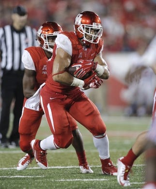 Oct 8, 2015; Houston, TX, USA; University of Houston Cougars running back Kenneth Farrow (35) takes a handoff from quarterback Greg Ward, Jr. (1) against the Southern Methodist University Mustangs in the second half at TDECU Stadium. Mandatory Credit: Erich Schlegel-USA TODAY Sports