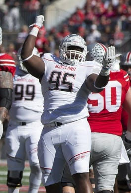 Oct 10, 2015; Columbus, OH, USA; Maryland Terrapins defensive lineman Azubuike Ukandu (95) celebrates after sacking Ohio State Buckeyes quarterback Cardale Jones (12) (not pictured) at Ohio Stadium. Mandatory Credit: Greg Bartram-USA TODAY Sports