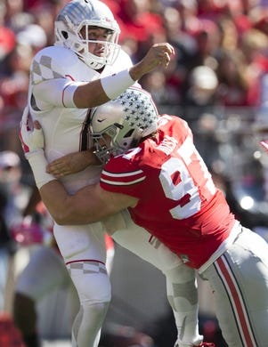Oct 10, 2015; Columbus, OH, USA; Maryland Terrapins quarterback Perry Hills (11) is hit by Ohio State Buckeyes defensive lineman Joey Bosa (97) at Ohio Stadium. Mandatory Credit: Greg Bartram-USA TODAY Sports